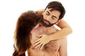 Beautiful woman kissing man's neck. Royalty Free Stock Photo