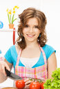 Beautiful woman in the kitchen picture of Royalty Free Stock Image