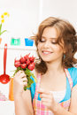Beautiful woman in the kitchen picture of Stock Image