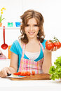 Beautiful woman in the kitchen picture of Stock Photo