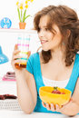 Beautiful woman in the kitchen picture of Royalty Free Stock Photo
