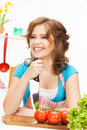 Beautiful woman in the kitchen picture of Royalty Free Stock Images