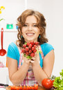 Beautiful woman in the kitchen picture of Stock Photography