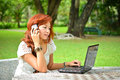 Beautiful woman with laptop in the garden Royalty Free Stock Photography