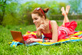 Beautiful woman with laptop on grass Royalty Free Stock Photo