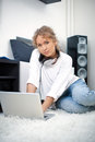 Beautiful woman with laptop sitting on the floor Stock Images