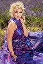 Beautiful woman in lavender dress vivid Royalty Free Stock Photos