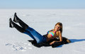 Beautiful woman laying snow baltic sea wearing jeans swimsuie Stock Images