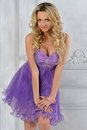 Beautiful woman in lilac short dress. Royalty Free Stock Photos