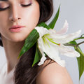 Beautiful woman with lily Stock Photo