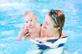 Beautiful woman and little baby boy in swimming pool women a having fun a poop Stock Images