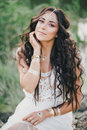 Beautiful woman with long curly hair dressed in boho style dress posing near lake young Stock Photos