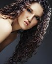 Beautiful woman with long curly hairs young Stock Image