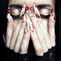 Beautiful woman with long designer nails Stock Image