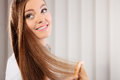 Beautiful woman with long hair and comb Royalty Free Stock Photo