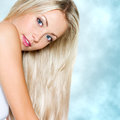 Beautiful woman with long straight hair blond Stock Photography