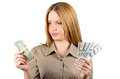 Beautiful woman looking at a dollar in cash Stock Images