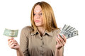 Beautiful woman looking at a dollar and helpless shrug Stock Image