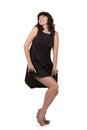 Beautiful woman looking like Marilyn Monroe standing in a black dress. Royalty Free Stock Photo