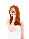 Beautiful woman looking through a magnifying glass over white background Stock Image