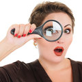 Beautiful woman looking through surprised a magnifying glass isolated over white background Royalty Free Stock Photo