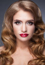 Beautiful woman looks softly and fascinating with red lips with eyes Royalty Free Stock Photo