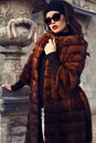 Beautiful woman in luxurious fur coat and sunglasses fashion outdoor photo of sexy glamour with dark hair wearing posing autumn Stock Photography