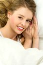 Beautiful woman lying in bed Royalty Free Stock Photos