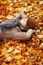 Beautiful woman lying on forest floor Stock Photo