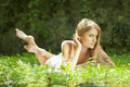 Beautiful Woman lying on the grass, rest in nature Stock Photo