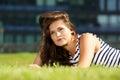 Beautiful woman lying on grass thinking Royalty Free Stock Photo