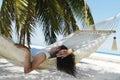 Beautiful woman lying in hammock Stock Photos