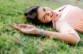 Beautiful woman lying outdoors portrait of a and smiling Stock Photography