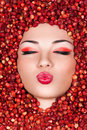 Beautiful woman lying in wild strawberry Royalty Free Stock Photo