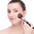 Beautiful woman with make up brush Royalty Free Stock Image