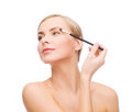 Beautiful woman with makeup brush cosmetics health and beauty concept Stock Images