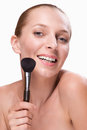 Beautiful woman with makeup brush isolated on white background Stock Images