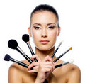 Beautiful woman with makeup brushes Royalty Free Stock Image
