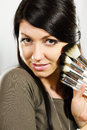 Beautiful woman with makeup brushes Stock Photo