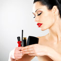 Beautiful woman makeup cosmetic tools near her face Royalty Free Stock Image