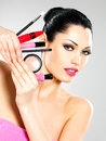 Beautiful woman makeup cosmetic tools near her face Stock Image