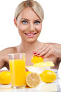Beautiful woman making lemonade young fresh Royalty Free Stock Photography
