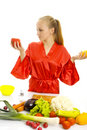 Beautiful woman making vegetable salad. Stock Image