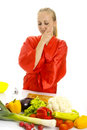 Beautiful woman making vegetable salad. Stock Photography