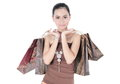 Beautiful woman with many shopping bags asian isolated on white background Royalty Free Stock Photography