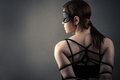Beautiful woman in mask and bondage Royalty Free Stock Photo