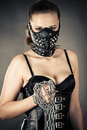 Beautiful woman in a mask with a chain Royalty Free Stock Photo