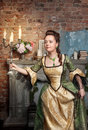 Beautiful woman in medieval dress with burning candles young long Royalty Free Stock Image