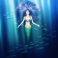 Beautiful woman mermaid in the sea fantasy with fish tail and purple hair swimming under water Stock Photos