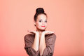 Beautiful woman model with chignon on her head orange studio shot Stock Images